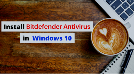 Wooden desk with laptop coffee and pad with text of Install Bitdefender Antivirus in Windows 10